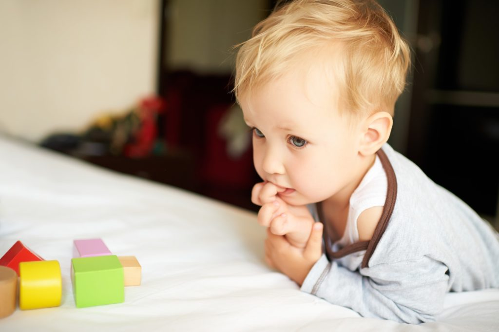Cute little boy playing with blocks.