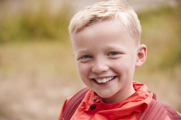 Portrait of pre-teen Caucasian boy outdoors, front view